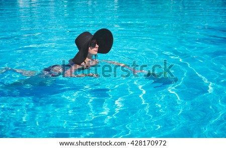 woman enjoying life in a swimming pool