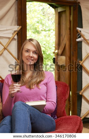Woman Enjoying Luxury Camping Holiday In Yurt - stock photo