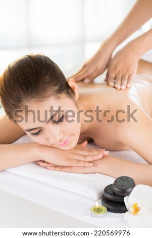Woman enjoying professional back massage in the spa salon - stock photo
