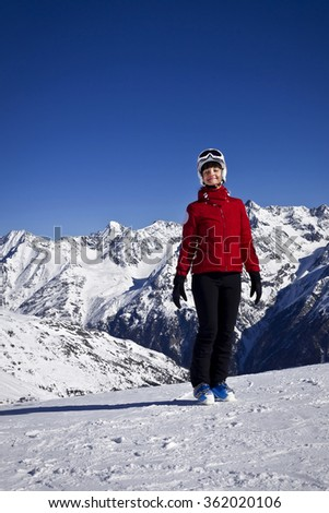 Woman enjoying skiing in alps