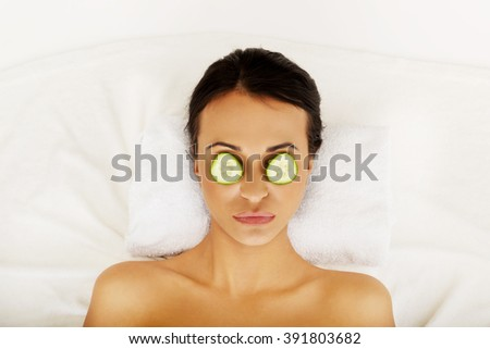 Woman enjoying spa, having cucumber on eyes - stock photo