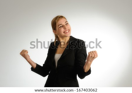 Woman enjoying success with clenched fists - stock photo