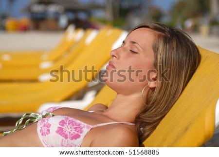 woman enjoying the beach on nice day - stock photo