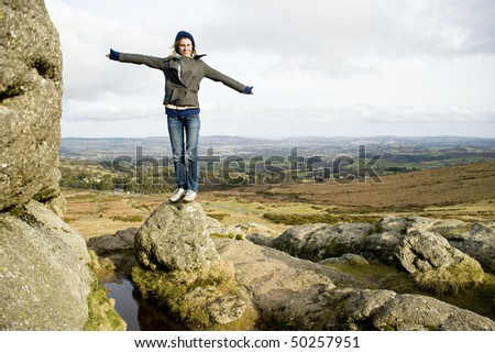 Woman Enjoying The Freedom Of Being Outside - stock photo