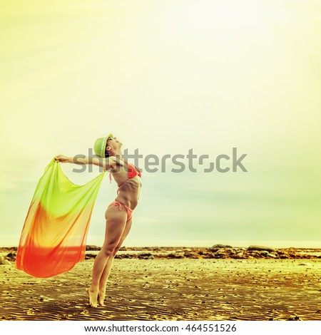 Woman enjoying the outdoors in the sun .