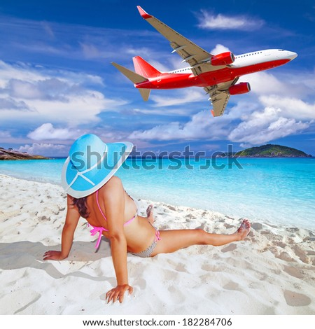 Woman enjoying tropical holidays on the beach - stock photo