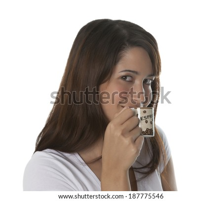 Woman enjoys a cup of espresso - stock photo