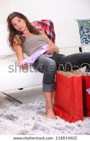 Woman examining her purchases - stock photo