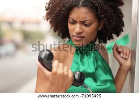 Woman examining the phone - stock photo