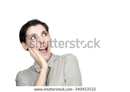 woman excited looking to the side. Surprised happy young woman looking sideways in excitement. - stock photo
