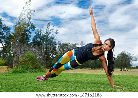 woman exercising outdoors - stock photo