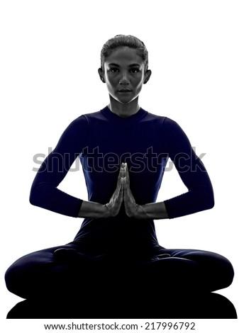 woman exercising Padmasana lotus pose yoga silhouette shadow white background - stock photo