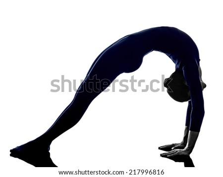 woman exercising Urdhva Dhanurasana bridge pose yoga silhouette shadow white background - stock photo