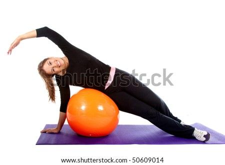 Woman exercising with a pilates ball - isolated over a white background