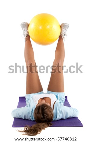 Woman exercising with a pilates ball - isolated over a white background - stock photo