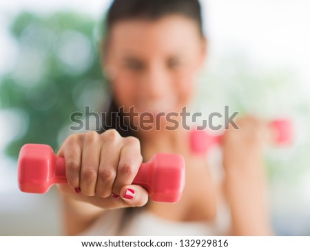 Woman Exercising With Dumbbells, Indoors