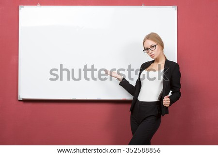 woman explain at the whiteboard. girl student - stock photo
