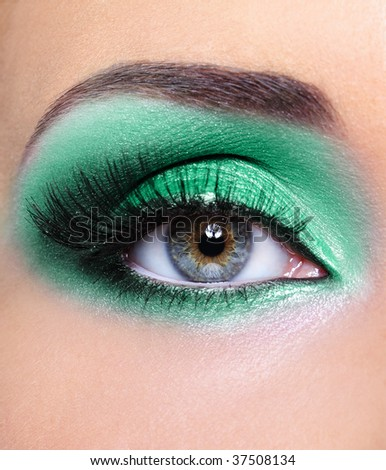 woman eye with a green eyeshadow - fashion make-up