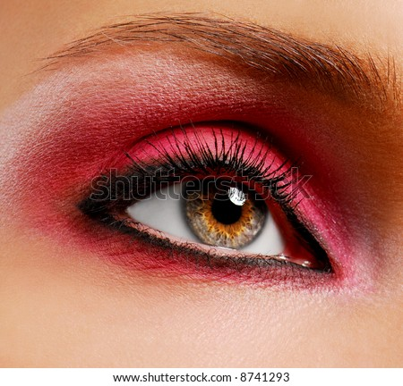 Woman eye with ceremonial bright pink make-up
