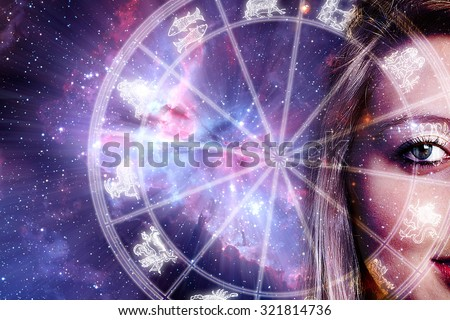 woman face and zodiac chart - background image provided by NASA - stock photo