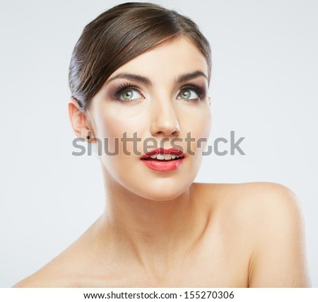 Woman face close up beauty portrait. Female model poses on white background.