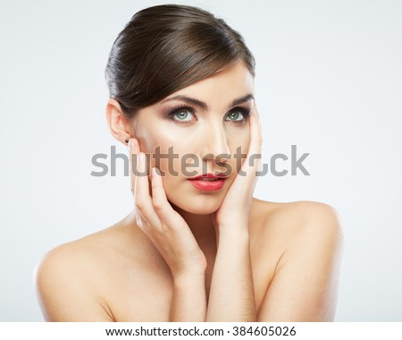 Woman face close up beauty portrait. Female model poses on white background. - stock photo