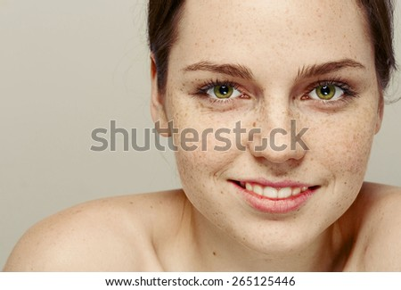 Woman  face freckled young beautiful healthy skin and long hair portrait - stock photo