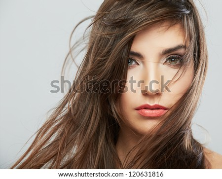 Woman face with hair motion on white background isolated close up portrait. Female model with long hair. - stock photo