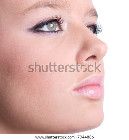 Woman face with makeup closeup. Isolated on white. - stock photo