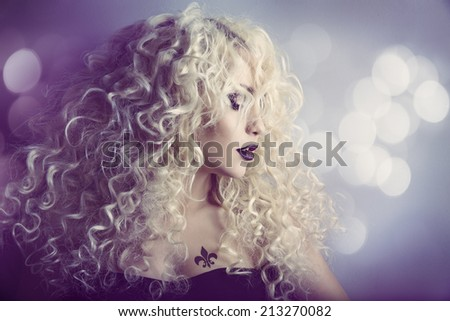 Woman Fashion Beauty Portrait, Model Girl Hairstyle with Blond Curly Hair, Beautiful Makeup, Long Curls and Tattoo - stock photo