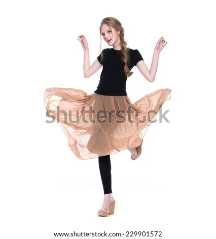 Woman Fashion Model in Gorgeous Light Dress posing in studio Concept - stock photo