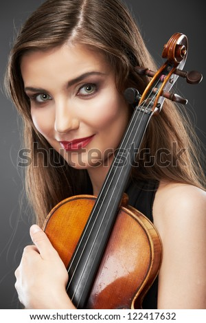Woman fashion style  portrait with violin music instrument  . isolated. close up female face.
