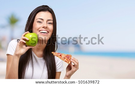 woman, fast food or fruit choice at the beach