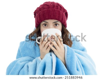 Woman feeling cold and drinking warm tea - stock photo