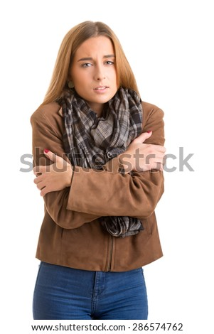 Woman feeling cold, isolated in white - stock photo
