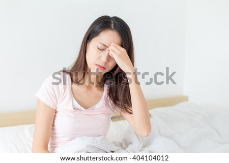 Woman feeling eye pain