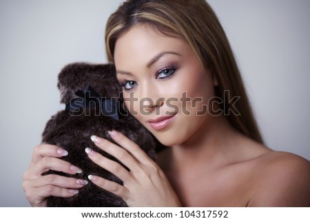 woman feeling nice and warm next to a hot water bottle - stock photo