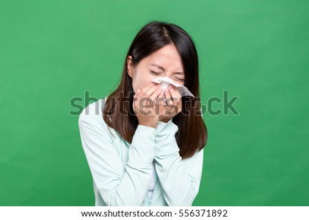 Woman feeling sneeze