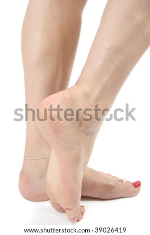 Woman feet  and legs isolated over white