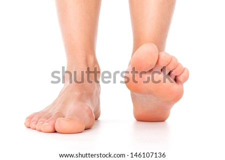 Woman feet isolated - stock photo