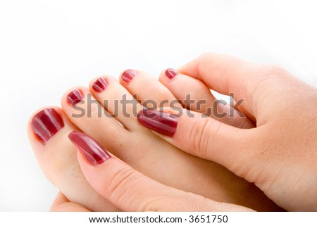 Woman feet massage isolated in white background