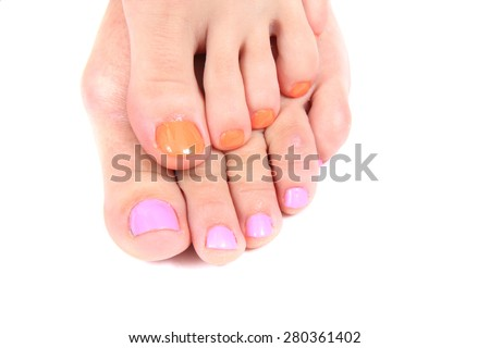 woman feets and colors (pedicure) isolated on the white background