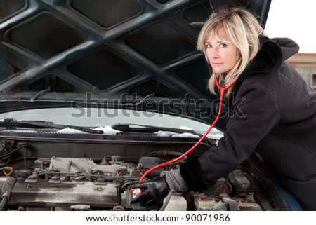 Woman figuring out what`s wrong with her car - stock photo