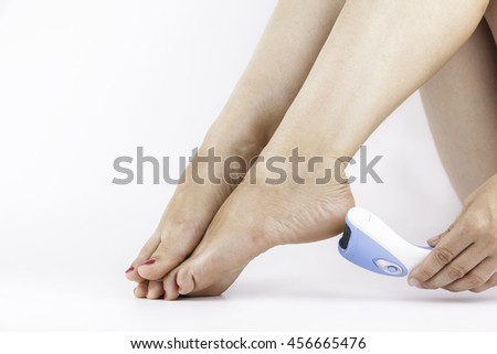 Woman Filing Foot With Foot File