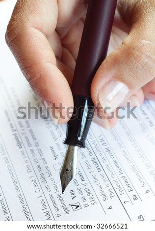Woman filling form - close-up - stock photo