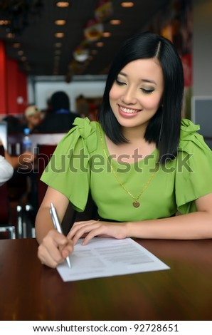 Woman filling the form on job interview - stock photo