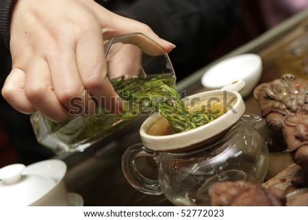 Woman filters china tea in market, Beijing - stock photo