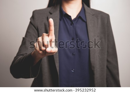 woman finger pointing at the camera - stock photo
