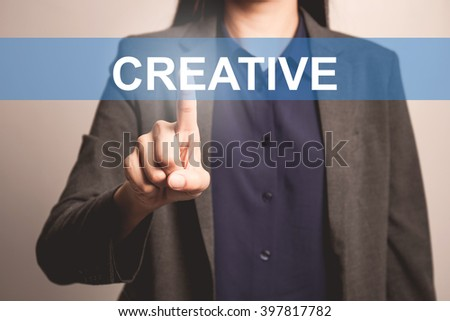 woman finger pointing at the camera with creative word - stock photo