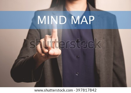 woman finger pointing at the camera with mind map - stock photo